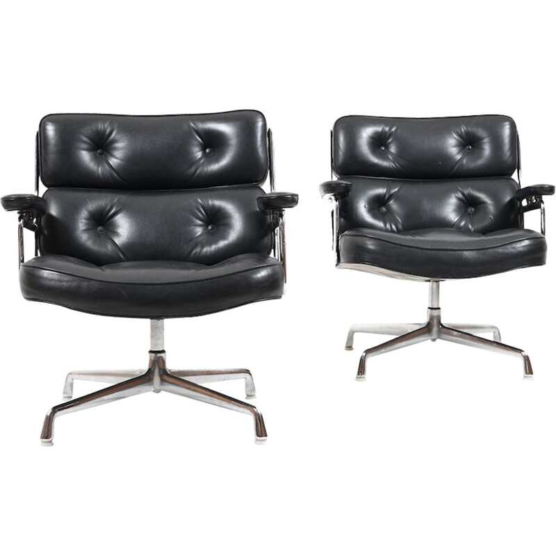 Vintage pair of black leather armchairs by Charles and Ray Eames,1950
