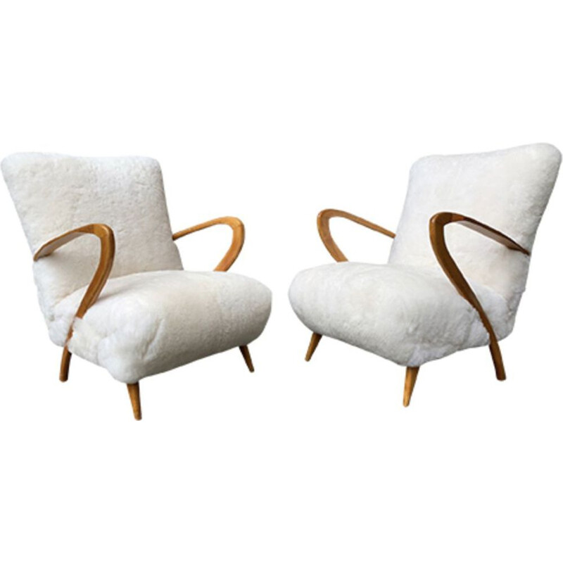 Pair of vintage armchairs by Giuglielmo Ulrich in sheepskin and wood 1960