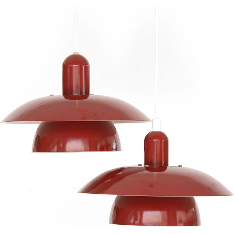 Pair of red pendant lamps by Hamalux