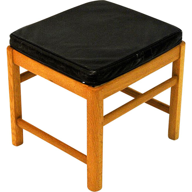 Vintage Scandinavian stool in oak with black leather seat from the 60s
