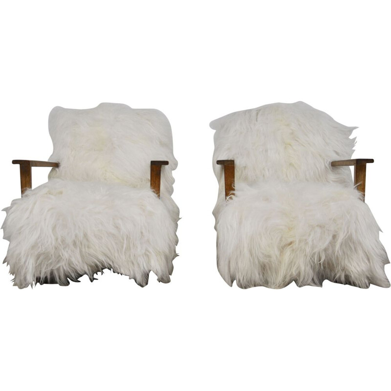 Pair of vintage armchairs in sheepskin and wood 1960
