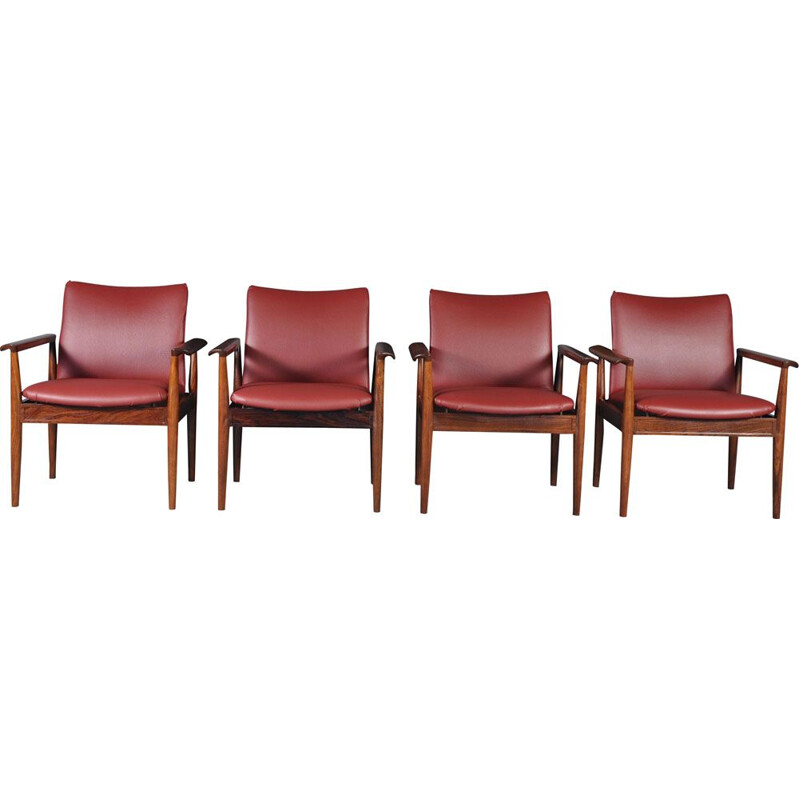 Set of 4 vintage 209 Diplomat chairs for Cado in rosewood and red leatherette 1960s
