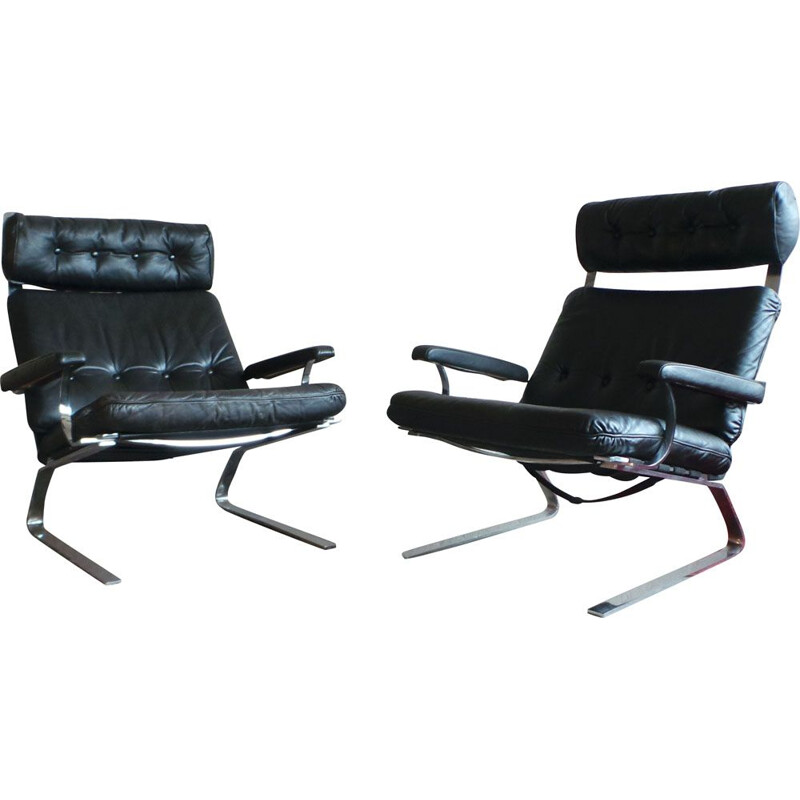 Pair of black leather and steel lounge chairs