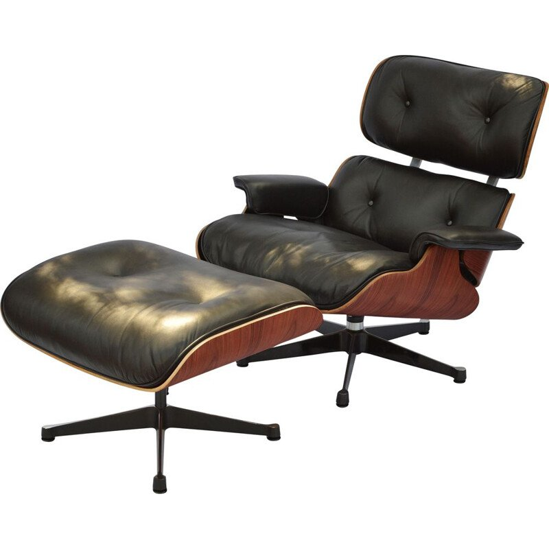 Vintage lounge chair & ottoman in rosewood Eames for Herman Miller 1964