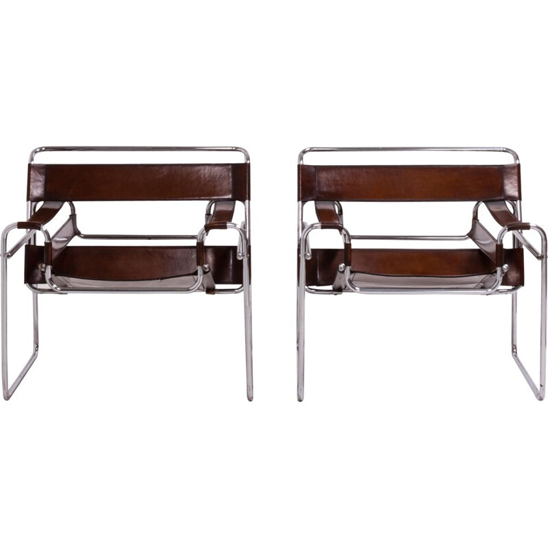 2 chairs in leather and chrome from the 60s