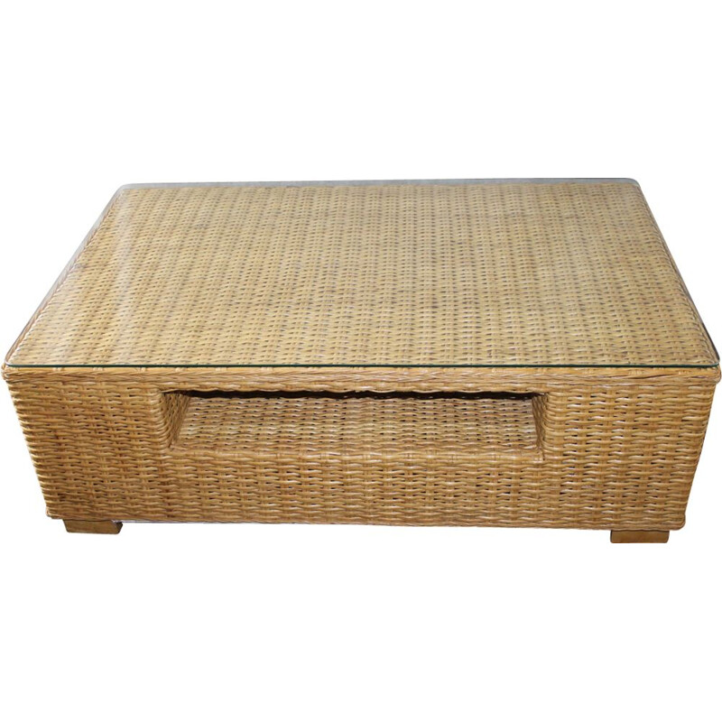 Vintage coffee table made of glass and rattan