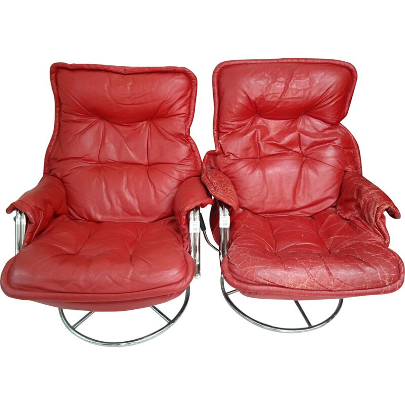 Set of 2 vintage armchairs in red leather and chrome plated 1970s