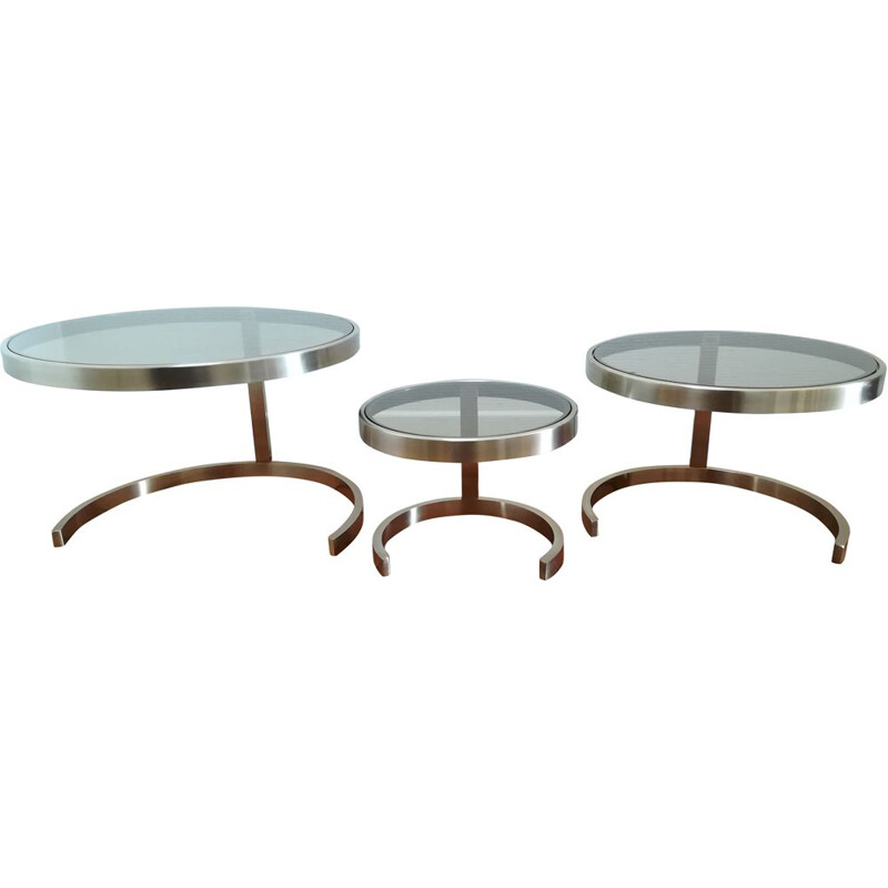 Three vintage nesting tables in brushed steel and glass, 1970
