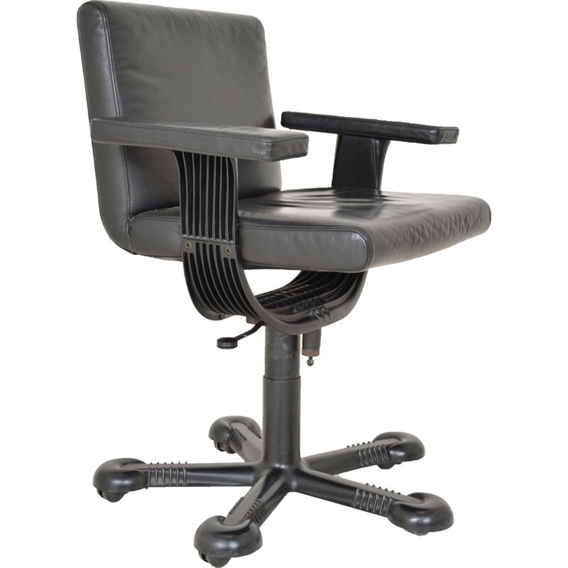 Vintage deskchair swivelling on wheels, in black leather