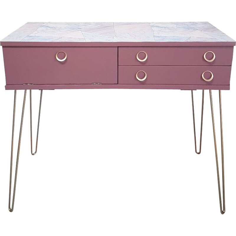 Pink vintage console with compass feet