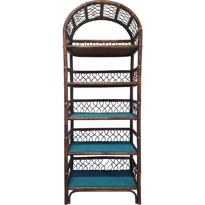 Vintage rattan shelf with geometric blue patterns
