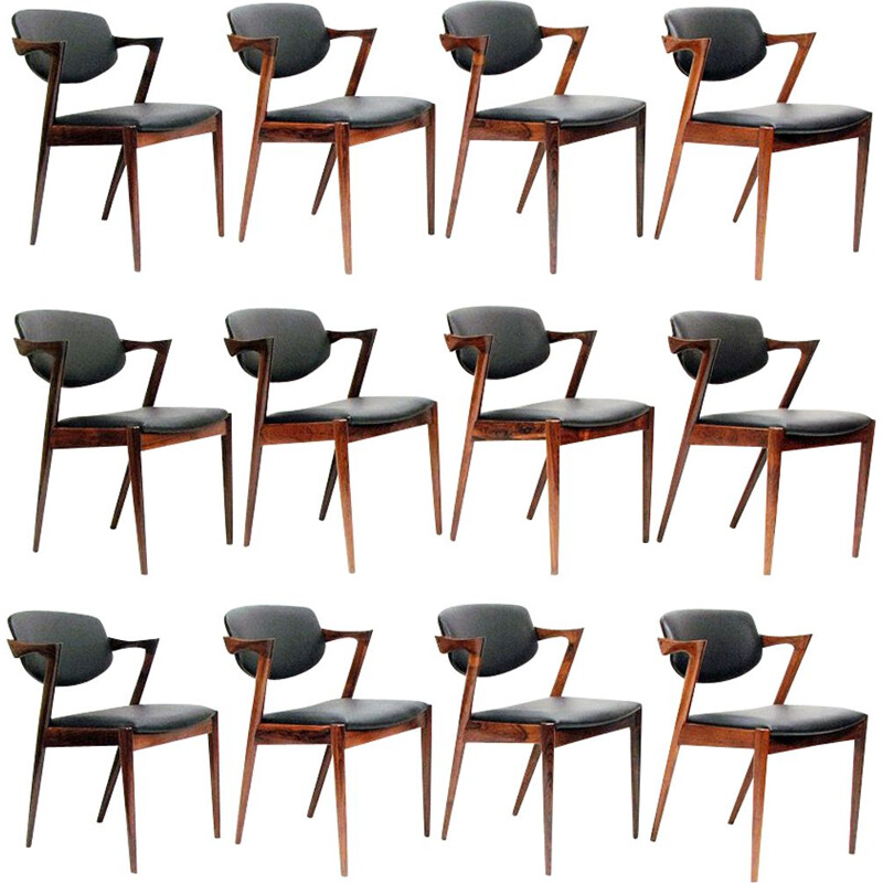 "Set of 12 vintage ""Model 42"" chairs in rosewood and Leather by Kai Kristiansen, 1965s"