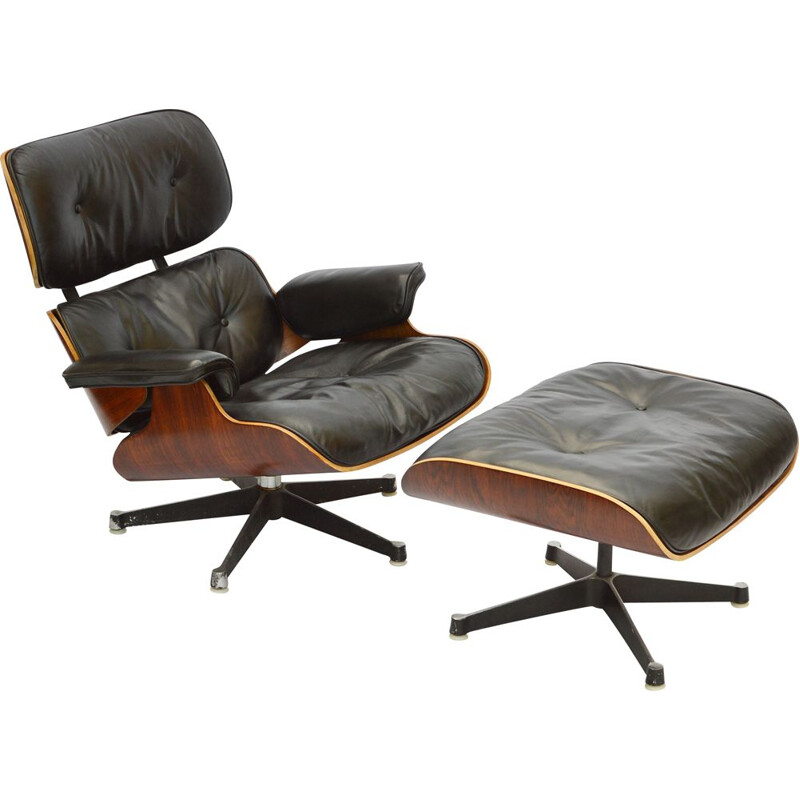 Vintage lounge chair & ottoman in rosewood by Herman Miller, 1963