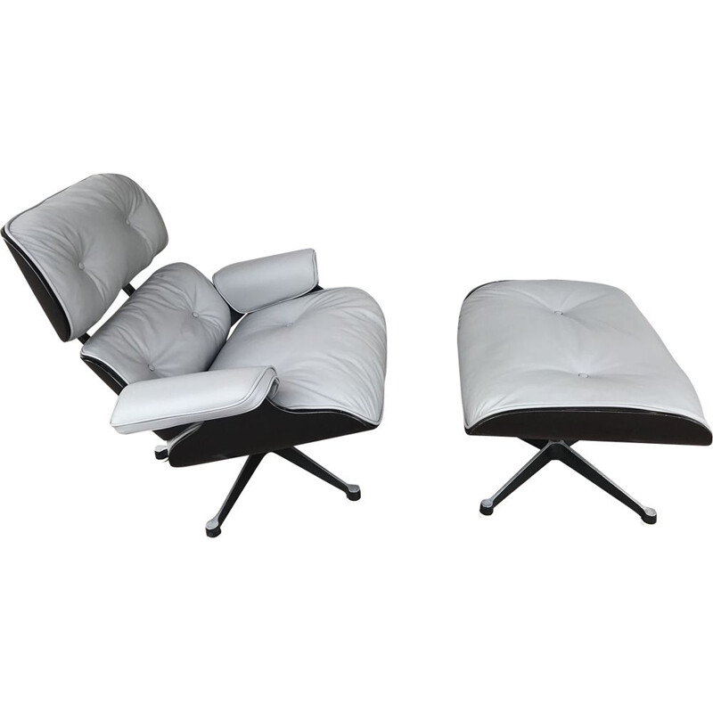 vintage Lounge chair and its Ottoman in Grey Leather and Black Ash by Charles Eames for Herman Miller, Circa 1974
