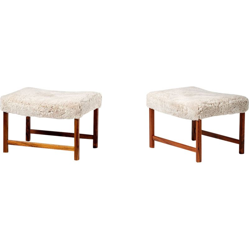 Pair of rosewood and leather stools by Ole Wanscher, 1950s