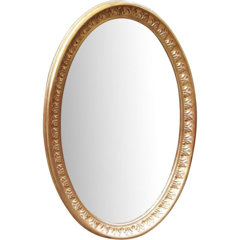 Vintage oval mirror in gilded wood