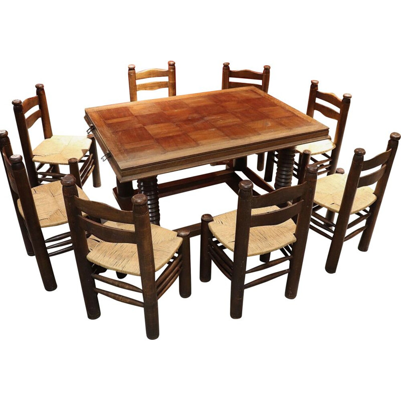 Vintage dining set with 1 table and 8 chairs by Charles Dudouyt in solid oak 1940