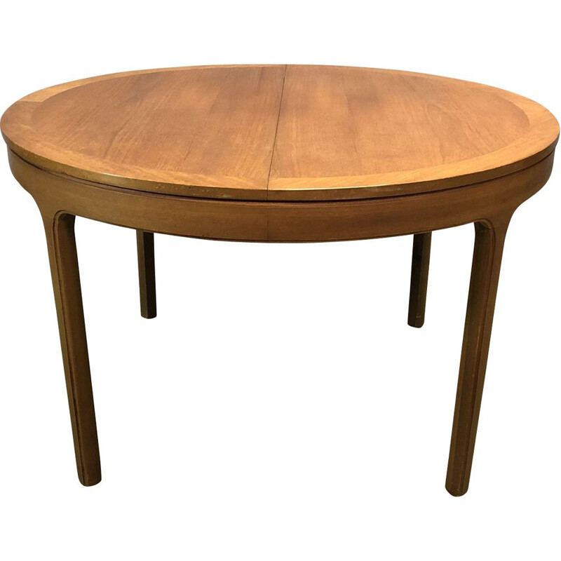 Vintage teak round table with its butterfly extension 1970
