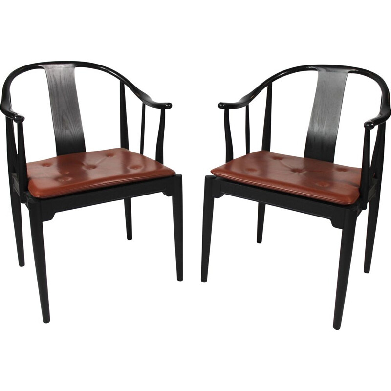 A pair of China chairs of black colored ash by Hans J. Wegner and Fritz Hansen in 2013.