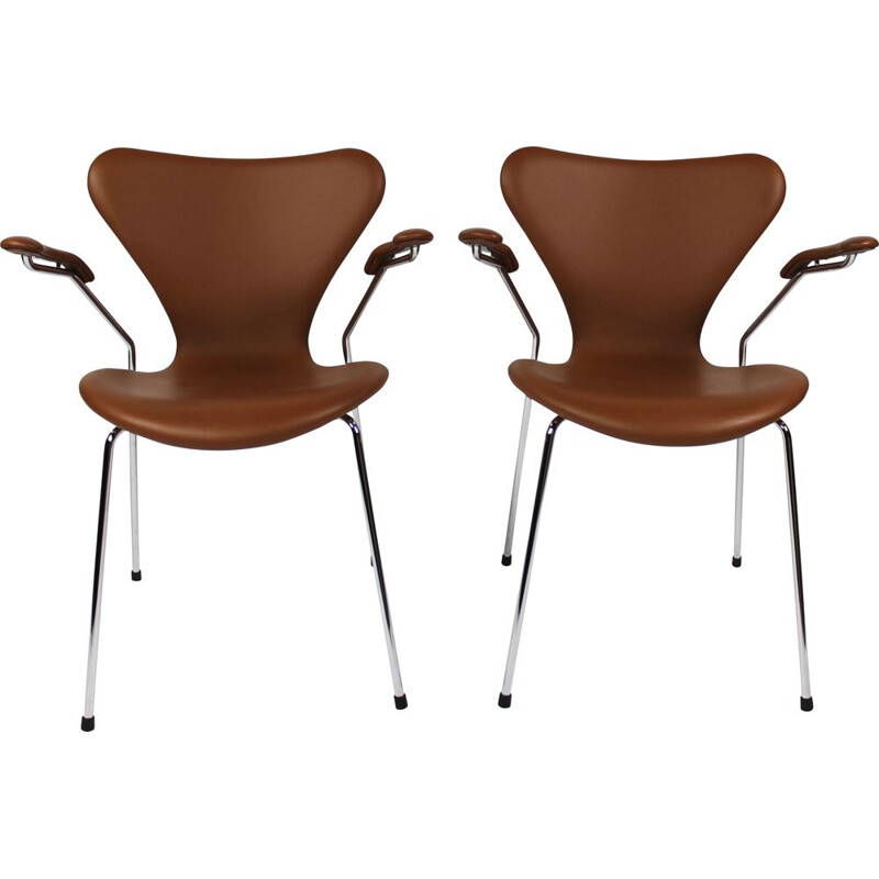 A set of seven chairs, model 3207, with armrests in cognac colored leather by Arne Jacobsen and Fritz Hansen, 2019.