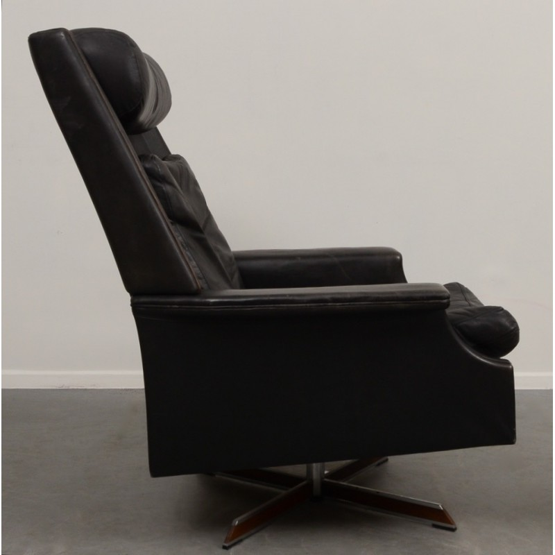 black swivel armchair with ottoman in leather and steel 1960s
