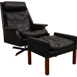 Black swivel armchair with ottoman in leather and steel - 1960s