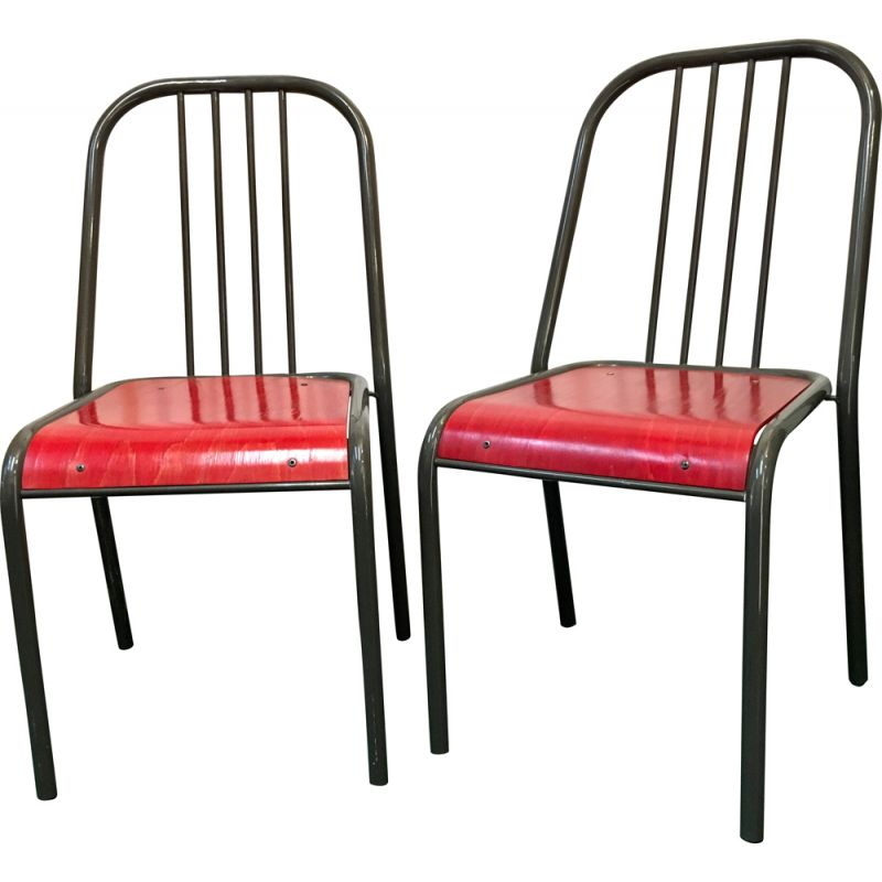 Pair of vintage chairs with red seats